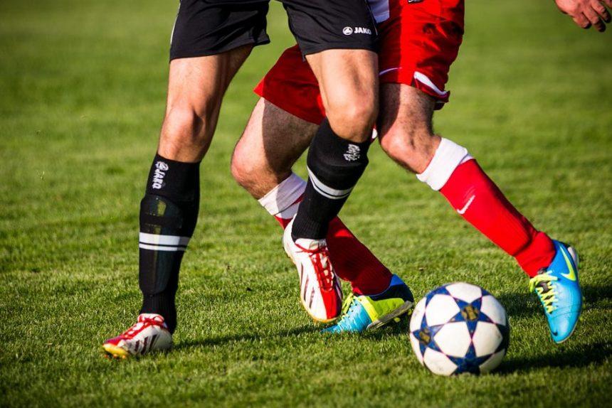 футбол футболисты футбольный мяч игра матч ноги бутсы