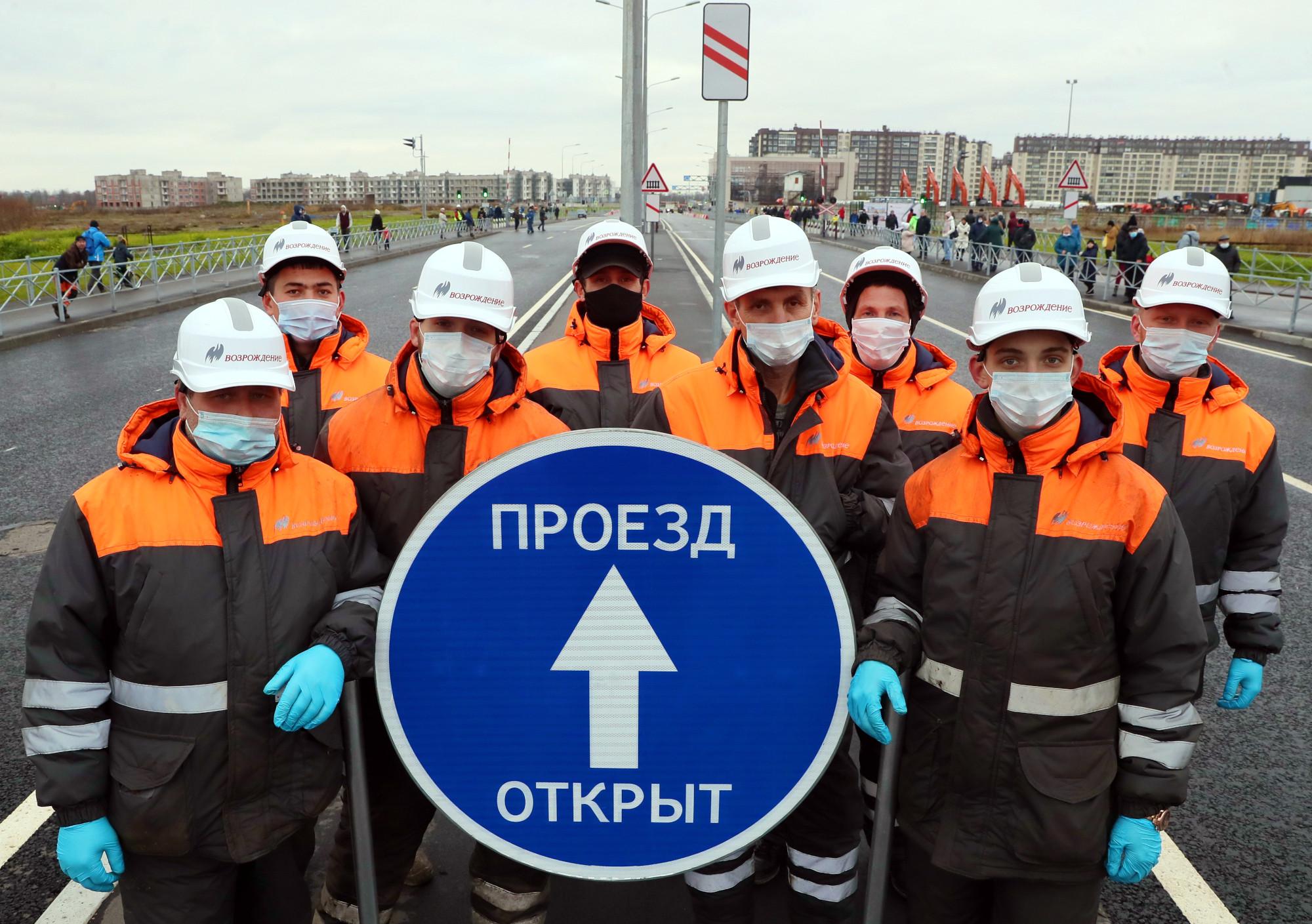 открытие проспекта Ветеранов, рабочие, дорожное строительство